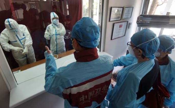 Members of Chinese medical expert team to Serbia visit a clinic in Belgrade, Serbia, April 11, 2020. (Chinese medical expert team to Serbia/Handout via Xinhua)