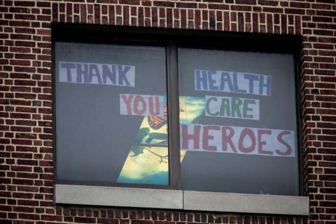 A message of thanks for healthcare workers is displayed on the window of the Brooklyn Hospital Center in the Brooklyn borough of New York, the United States, April 24, 2020. (Photo by Michael Nagle/Xinhua)