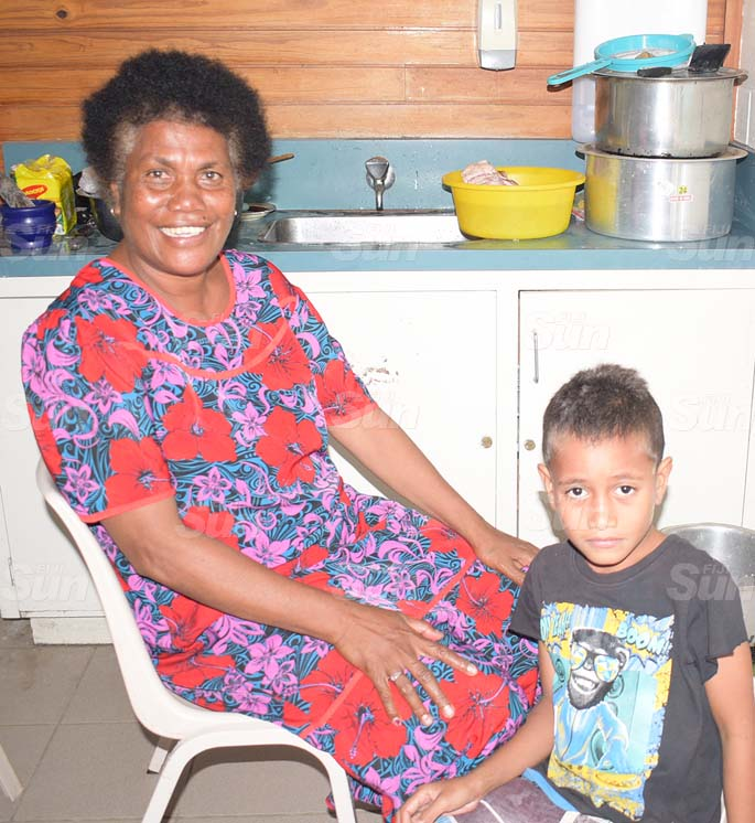 Mere Doro with her grandson, Keli Petero at LDS evecuation centre in Navua . Photo: Ronald Kumar.