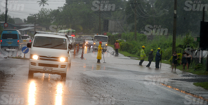Fiji Road Authority contractors clean the block drainage to clear the flood water in Nasinu and allow traffic flow on April 28, 2020. Photo: Ronald Kumar.