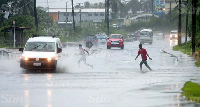 These children were seen playing in flooded road at Nasole in Nasinu on April 28, 2020. Photo: Ronald Kumar.