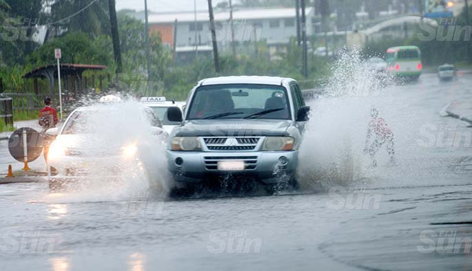 Children were seen playing in flooded road at Nasole in Nasinu on April 28, 2020. Photo: Ronald Kumar.