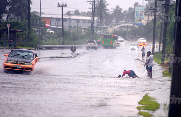 Children were seen swimming in flooded water on the main road along queens road in Nasole, Nasinu on April 28, 2020. Photo: Ronald Kumar.