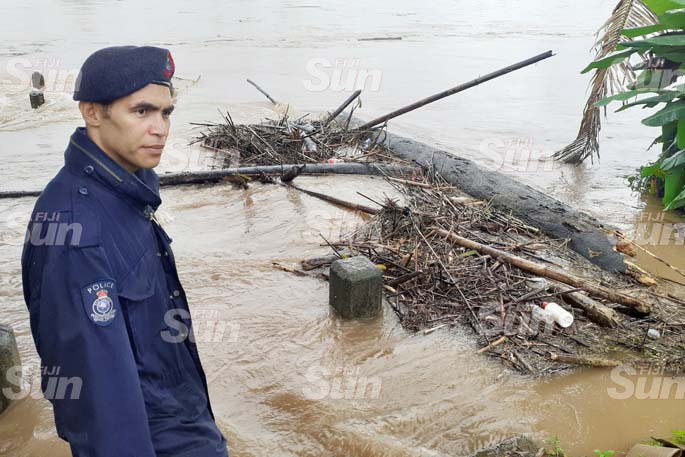Navua Police officer, Cpnt. Richard Wise  keeping close watch flood water in Navua River on April 8, 2020. Photo: Ronald Kumar.