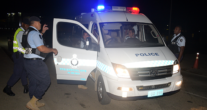 COVID-19 frontline workers include Police officers (top) manning checkpoints and members of the St John Ambulance. Photos: Ronald Kumar