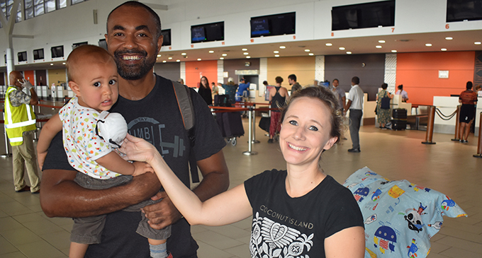 Paul Farrell Valemei holding 15-month-old Evan Inia Carter Valemei and Welsh-born Victoria Alice Carter at the Nadi International Airport on April 29, 2020.   Photo: Waisea Nasokia