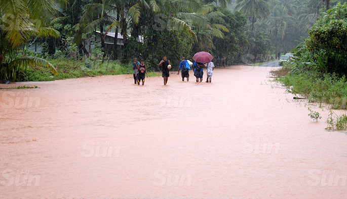 Muaivuso Road residents had to walk through flooded roads to reach home as the road was closed to all motorist due to flooding on April 27, 2020. Photo: Ronald Kumar.