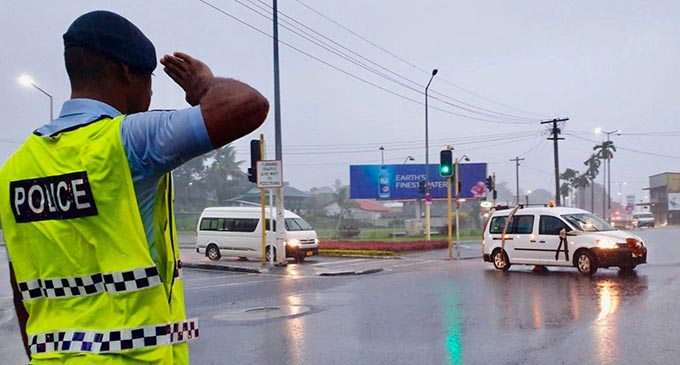 Ni Sa Moce Mada Laisenia Qarase..... A Police officer salutes the funeral cortege of Laisenia Qarase at the Samabula junction in Suva as it made its way to the Nausori International Airport on April 29, 2020. The former Prime Minister was laid to rest on his island in Vanuabalavu. Photo: Police Media Cell
