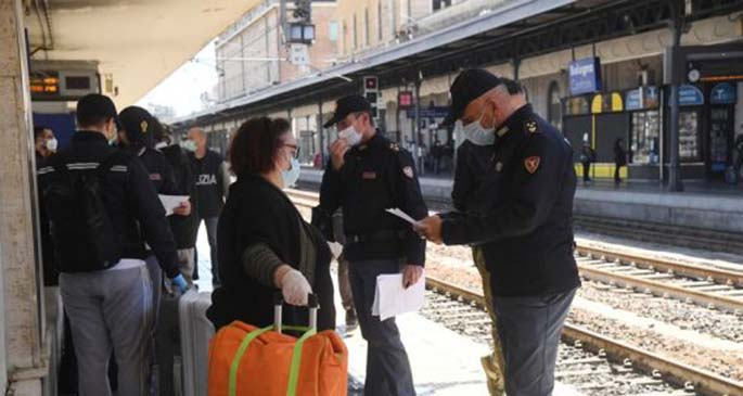 Police officers check on passengers at Bologna Central Station in Bologna, Italy, May 4, 2020. (Photo by Gianni Schicchi/Xinhua)