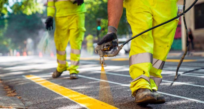 Workers paint a line on the street to adapt the mobility of pedestrians and ensure social distancing in Barcelona, Spain, May 19, 2020. (Barcelona City Hall/Handout via Xinhua)