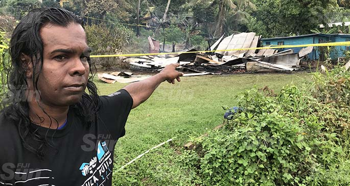Bal Krishna, the late Nagama's son, in front of what is left of their home after the fire killed his mother and her friends at Benau, outside of Labasa Town on April 30, 2020