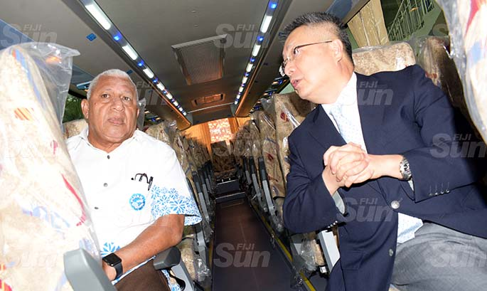 Prime Minister Voreqe Bainimarama (left) and Chinese Ambassador to Fiji Qian Bo following the handing over of two bus Fiji Rugby Union on May 21, 2020. Photo: Ronald Kumar.