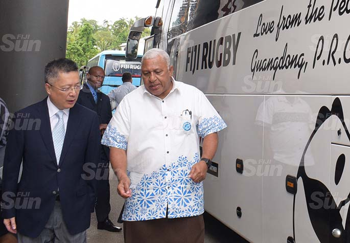Chinese Ambassador to Fiji Qian Bo (left) and Prime Minister Voreqe Bainimarama following the handing over of two bus Fiji Rugby Union on May 21, 2020. Photo: Ronald Kumar.