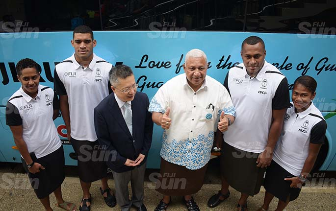 From left-Fijiana rep, Tokasa Seniasi, &s captain, Meli Derenalagi, Chinese Ambassador to Fiji Qian Bo, Prime Minister Voreqe Bainimarama, 7's rep, Paula Dranisinukula and Fijian rep Luisa Tisolo following the handing over of two bus Fiji Rugby Union on May 21, 2020. Photo: Ronald Kumar.