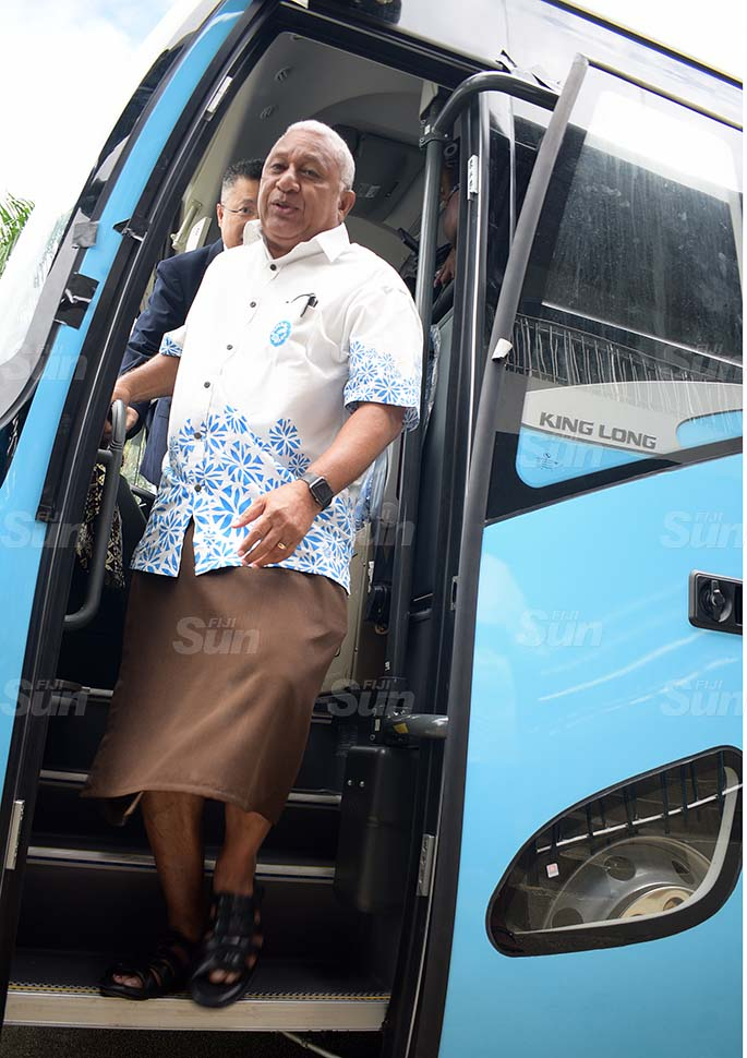 Prime Minister Voreqe Bainimarama followed by Chinese Ambassador to Fiji Qian Bo following the handing over of two bus Fiji Rugby Union on May 21, 2020. Photo: Ronald Kumar.