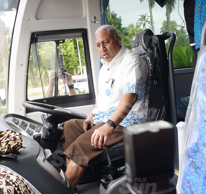 Prime Minister and Fiji Rugby Union president Voreqe Bainimarama tries out the 50-seater bus during the handover ceremony at Albert Park, Suva on May 21, 2020. Photo: Ronald Kumar