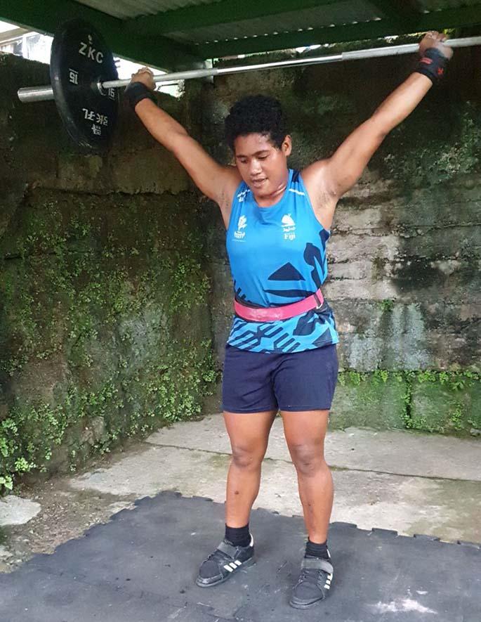 Weightlifting Fiji rep, Merewalesi Vusonitokalau training at the Elders home, where she resides . Photo: Henry Elder