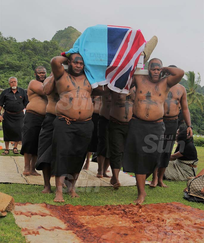 Pallbearers carry the casket of the late former prime minister into his home 'Naivaka'. Photo: Inoke Rabonu