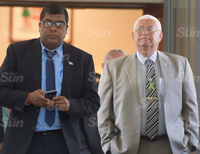 Minister for Water Ways Mahendra Reddy (left) and Assistant Health Minister Alex O'Connor outside Parliament on 27, 2020. Photo: Ronald Kumar.