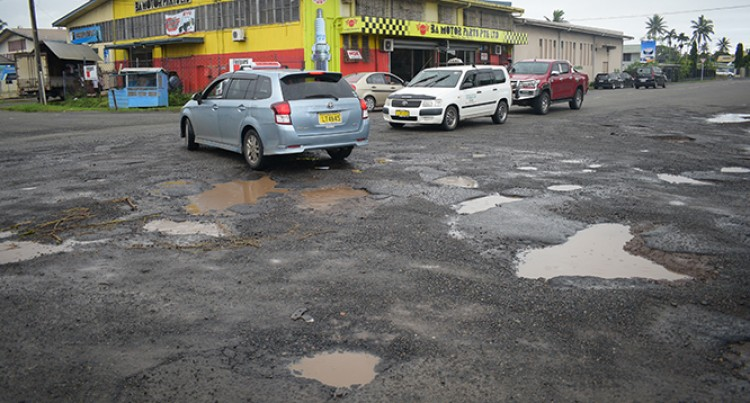 Potholes On Our Roads Beyond Repair: Moore