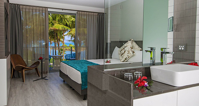 Interior of a Premium Marina View room at The Pearl Resort.