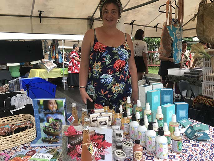 fj Laura Cahir of Fiji Beachhouse with a Pacific range of products on sale at Suva Roc Market yesterday. Photo: Frederica Elbourne