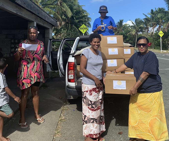 The Rotary Club of Lautoka (District 9920) Youth Ambassador and Projects, Melissa Natawake (right) with members of the club during their distribution to the Korotogo families at Malevu and KorotogaoVillage in Sigatoka.