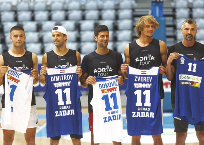 Serbian tennis player Novak Djokovic (C) poses with Borna Coric (1st L), Grigor Dimitrov (2nd L), Alexander Zverev (2nd R) and Goran Ivanisevic after a friendly basketball match ahead of the Adria Tour humanitarian tennis tournament in Zadar, Croatia, June 18, 2020. (Marko Dimic/Pixsell via Xinhua)