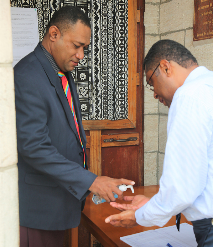 Ministry of Health Chief Medical Advisor, Doctor Jemesa Tudravu (left) gets his hands sanitised before entering the Centenary Methodist Church on June 28, 2020. Photo: Inoke Rabonu