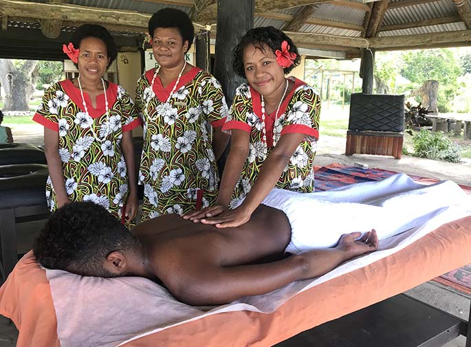 From left, Teresia Buicagi, Varanisese Naiobasali watch as Titilia Naisebua massages a local visitor on June 16, Photo Charles Chambers