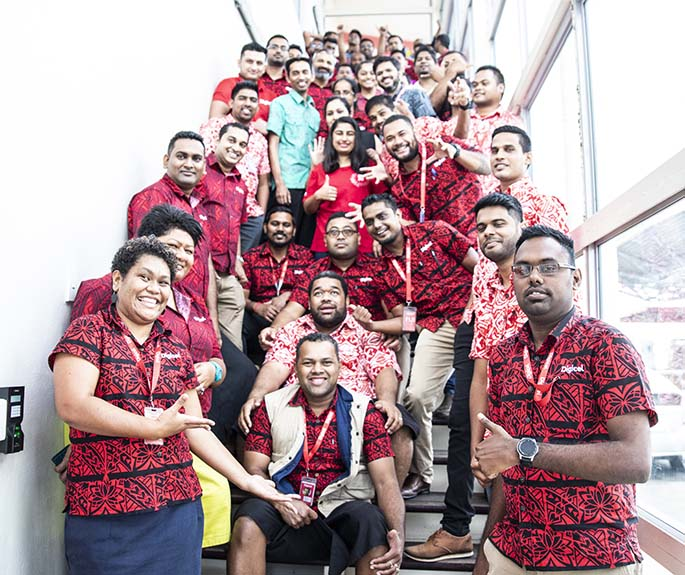 Digicel Fiji chief executive officer Mohammed Farid (standing middle light blue shirt) with staff at the Digicel Office- Khalsa Road on June 5, 2020.
