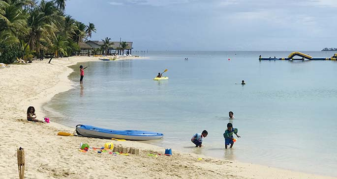 Locals enjoying the immaculate beach and sea at Plantation Island Resort on June 27. Photo: Charles Chambers