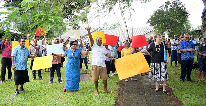 University of South Pacific protesting staff with their plycard at USP on June 8, 2020. Photo: Ronald Kumar.