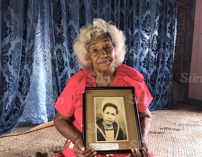 Mere Nagata with a portrait of 23-year-old Savenaca Naulumatua. Photo: Kelera Sovasiga