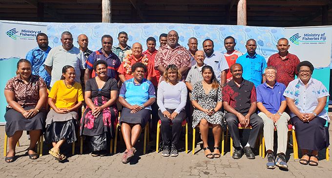 Laisiana Nayasi (front row, fourth from left) was part of the 13 aquaculture farmers who received bags of fish feed from the Minister for Fisheries, Semi Koroilavesau (second row, fourth from left) at the Port of Lautoka on July 20, 2020..  Photo: Nicolette Chambers