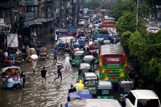 Photo taken on July 21, 2020 shows a flooded road in Dhaka, Bangladesh. (Xinhua)
