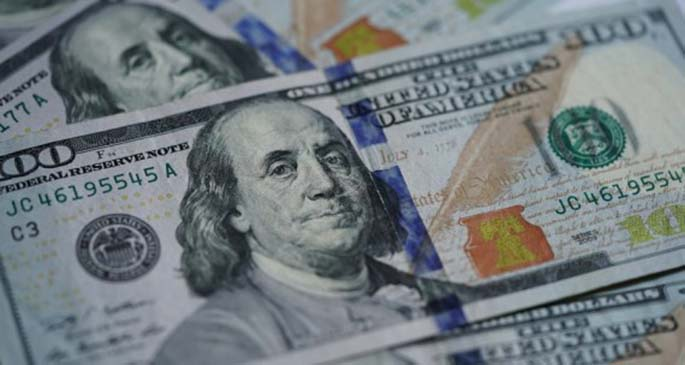 Photo taken on March 17, 2020 shows U.S. dollar banknotes in Washington, D.C., the United States. (Xinhua/Liu Jie)
