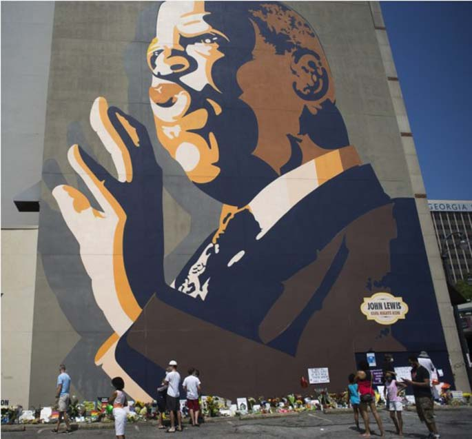 People mourn John Lewis, congressman representing the state of Georgia, near a mural of Lewis in Atlanta, Georgia, the United States, July 19, 2020. (Photo by Alan Chin/Xinhua)