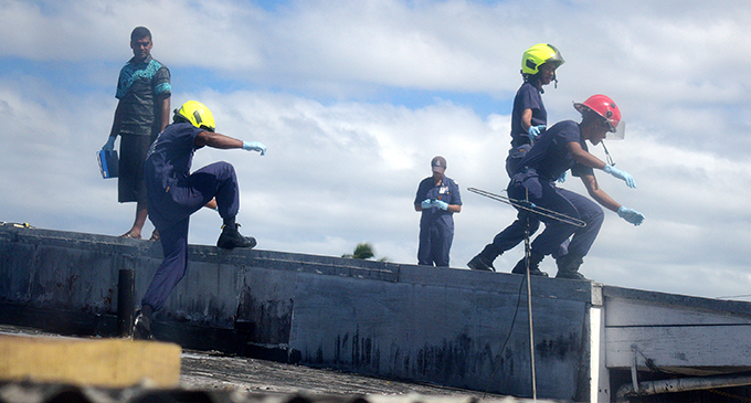A team from the National Fire Authority and Police at the property in Lami carrying out their investigations. Photo: Ronald Kumar