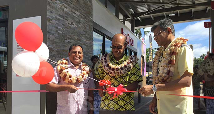 From left: Supreme Fuel Limited managing director Rajesh Patel, Minister for Infrastructure and Meteorological Services and Minister for Lands and Mineral Resources Jone Usmate and TOTAL Fiji managing director Kazi Rahman during the ribbon cutting session at the opening of the refurbished TOTAL Fiji service station in Korovou Town on July 16, 2020. Photo: Laiseana Nasiga