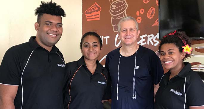 British Deputy High Commissioner to Fiji Paul Welsh (third from left) dropped in at Gloria Jean's after his morning run yesterday for coffee and croissants, where he was asked by staff for a group photo.