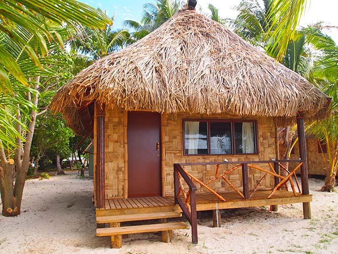 Beachfront villas at Leleuvia Island Resort.