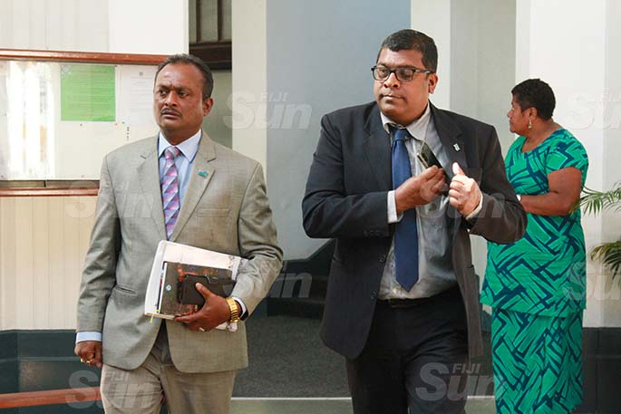 Assistant Minister for Rural and Maritime Development and Disaster Management, Vijay Nath and Minister for Agriculture, Waterways and Environment, Dr Mahendra Reddy outside of Parliament on July 29, 2020. Photo: Kelera Sovasiga