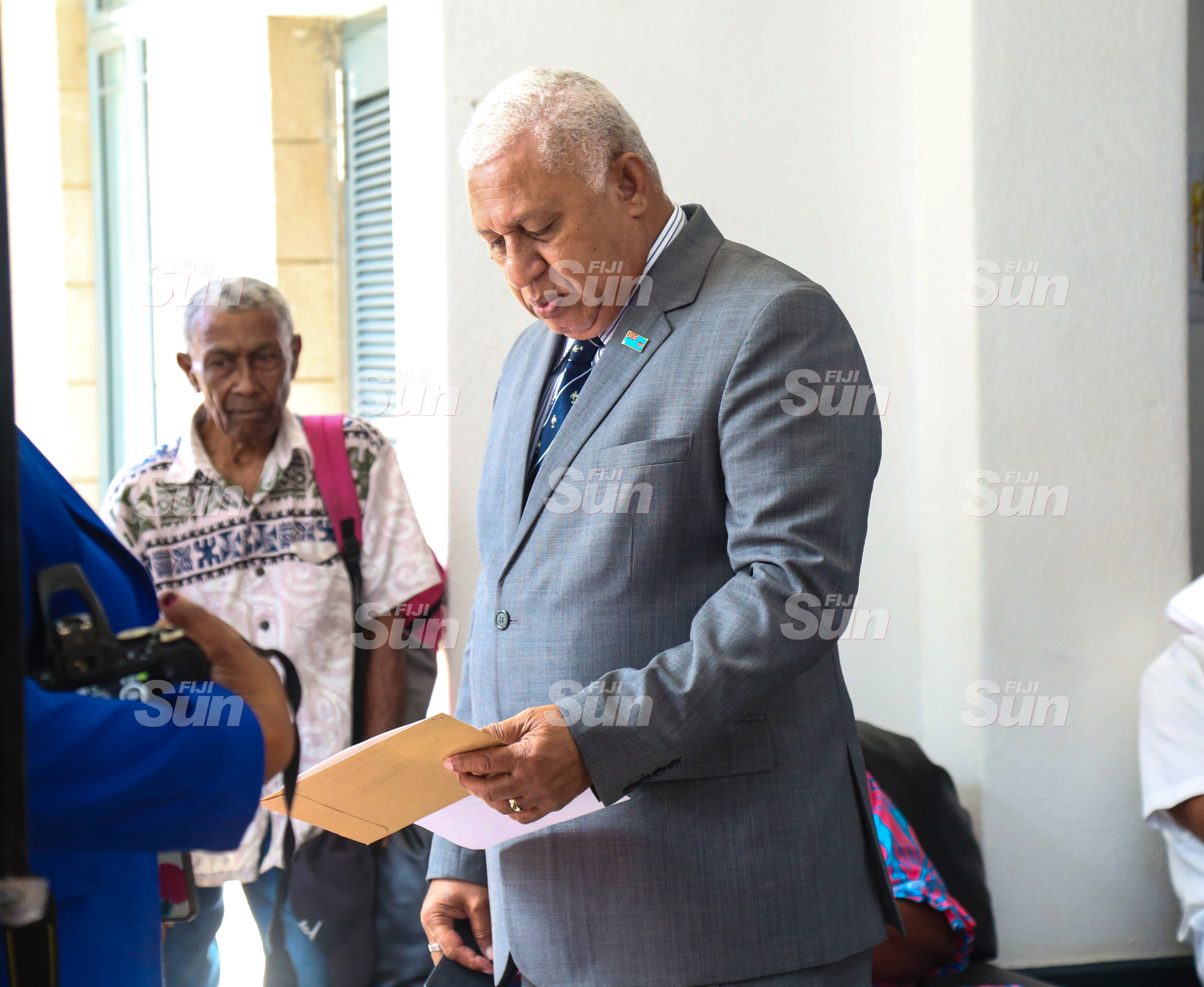 Prime Minister Voreqe Bainimarama with members of the public outside of Parliament on July 28, 2020. Photo: Kelera Sovasiga