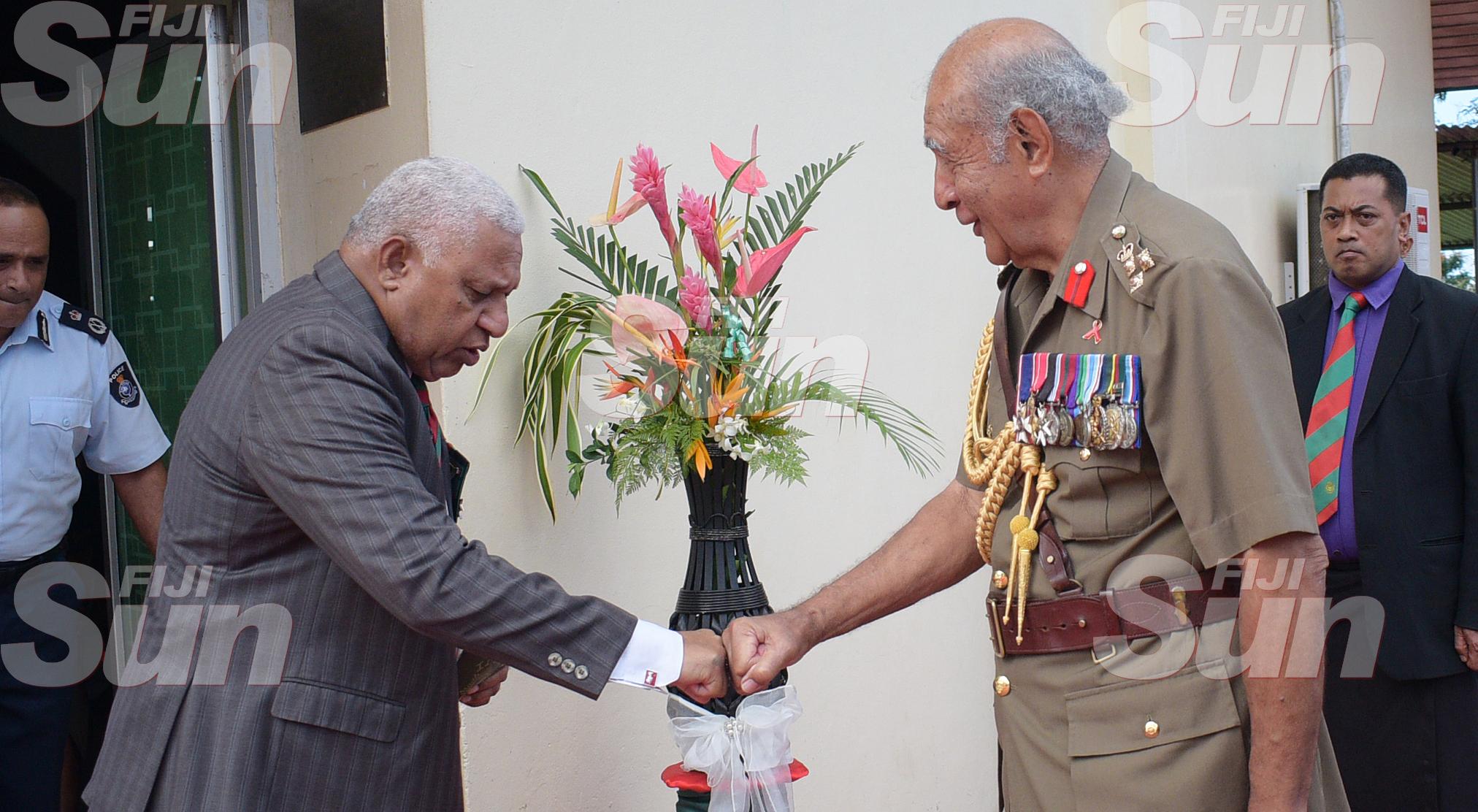 Prime Minister Voreqe Bainimarama congratulates Brigadier General (Retired) Ratu Epeli Nailatikau on his appointment Colonel of the Regiment at QEB Church on July 21, 2020. Photo: Ronald Kumar.
