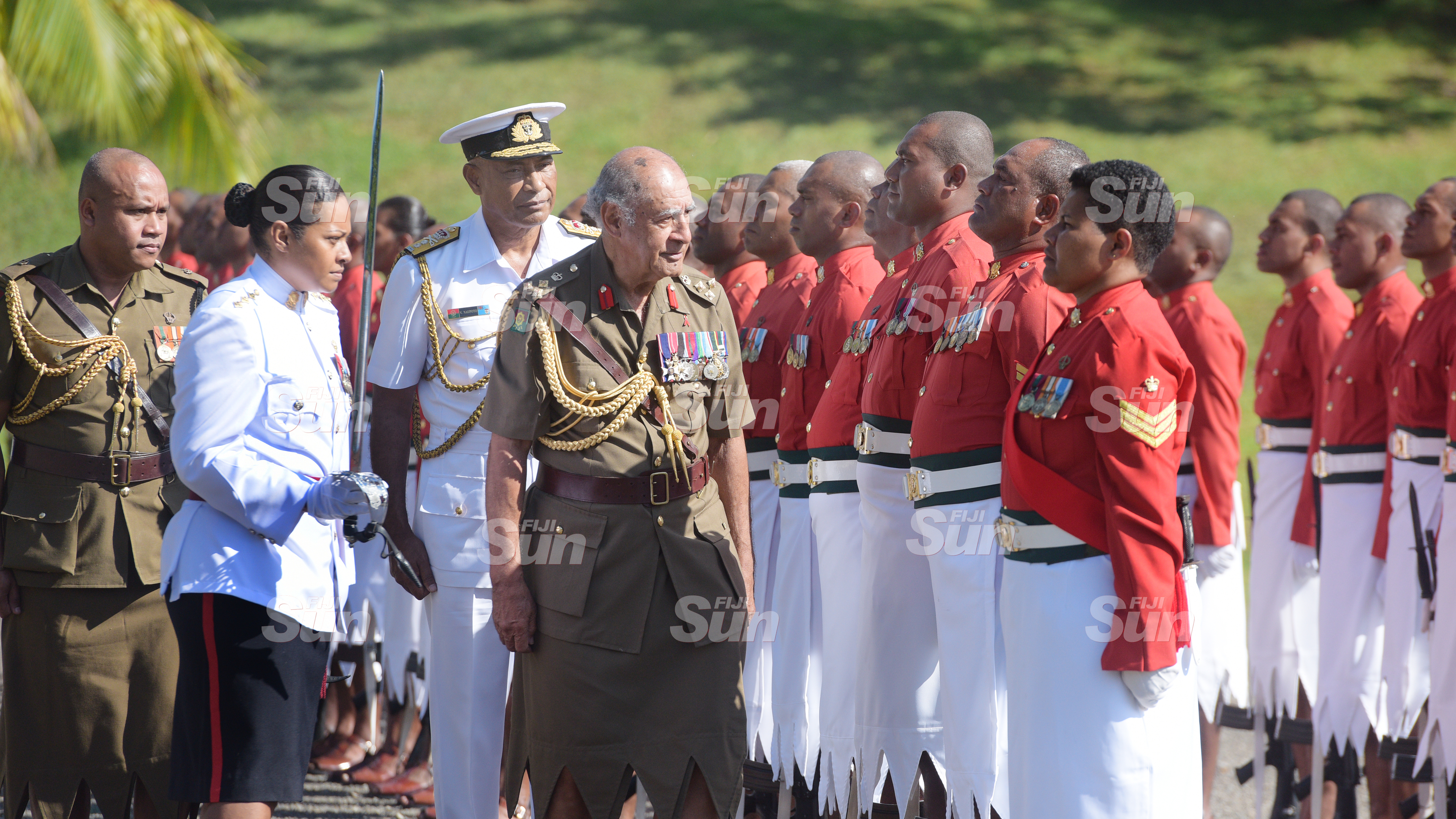 Captain Nina Vadewabuka and RFMF Commander Rear Admiral Viliame Naupoto walk Brigadier General (Retired) Ratu Epeli Nailatikau to inspect the 50 men regimental guard of honour at Queen Elizabeth Barracks during inauguration of the Colonel of the Regiment on July 21, 2020. Photo: Ronald Kumar.