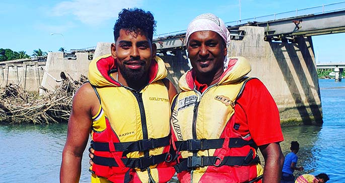 Soccer star Roy Krishna (left) and a friend trying out Sigatoka's river jet experience.