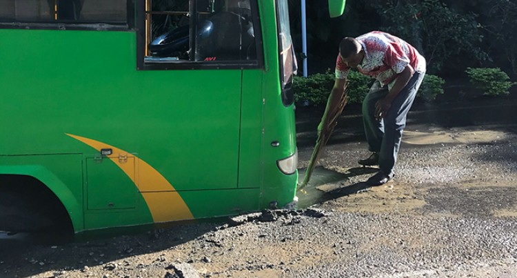 Huge Hole On Denarau Island Traps Bus