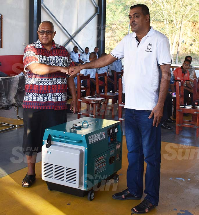 National Fire Authority chief executive officer Puamau Sowane (left) receives the generator from Lautoka Auto Mechanical and Air Con Services managing director, Arvin Chand. Photos: Waisea Nasokia