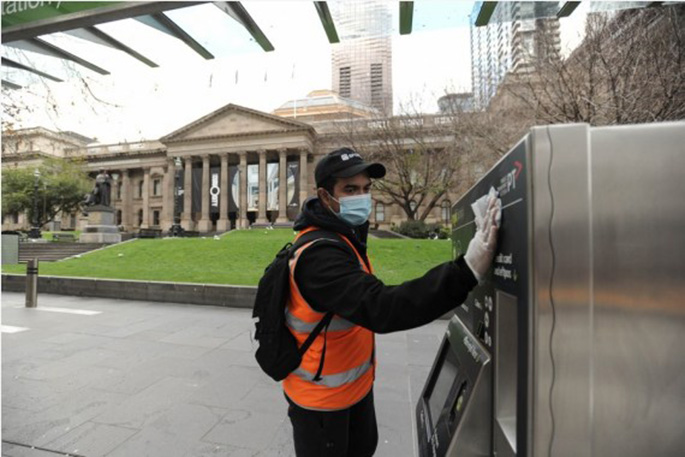 A sanitation worker cleans a facility in Melbourne, Australia, on Aug. 3, 2020. (Photo by Bai Xue/Xinhua)